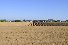 Ploughed field and houses stock photo