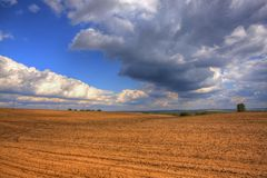 Ploughed field at late summer. HDR image. Poland, The Holy Cross Mountains stock photo