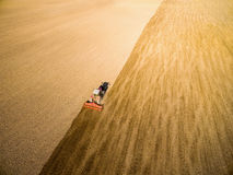 Ploughed field with tractor Stock Image