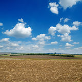 Ploughed field under clouds Stock Image