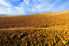Ploughed field under cloudy sky. Close up view at ploughed field under cloudy sky Stock Photography