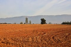 Ploughed Ground. Winter ploughing season beneath the Magaliesberg Mountains South Africa Stock Image