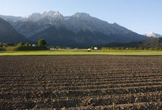 Ploughed land in the Alps Royalty Free Stock Image