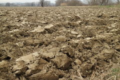 Ploughed land. In winter time along the river bank Stock Image