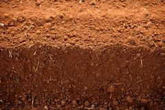 Ploughed red clay soil agriculture fields Royalty Free Stock Photo