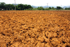 Ploughed red clay soil agriculture fields Royalty Free Stock Image