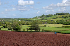 Ploughing. Tractor ploughing the land ready for seeding Stock Images