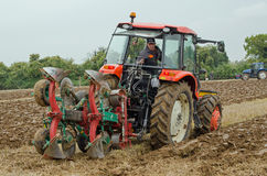 Ploughing Competition, Basingstoke. BASINGSTOKE, UK - OCTOBER 12, 2014: A competitor carefully places his equipment while taking part  in the second day of the Royalty Free Stock Photos