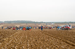 Ploughing Competition field. BASINGSTOKE, UK - OCTOBER 12, 2014: Competitors and spectators enjoying the second day of the British National Ploughing Stock Images
