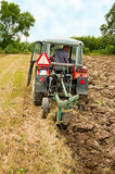 Ploughing field. On old tractor in southern Poland Royalty Free Stock Photos