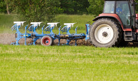 Ploughing a field Royalty Free Stock Image