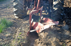 Ploughing the field in spring. Picture of a   farmer plough the field in spring Stock Photography