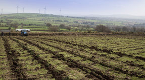 Ploughing a Field. A Tractor prepares to plough a field for planting Royalty Free Stock Photography