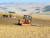 Ploughing the fields by machine Stock Photo