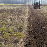 Ploughing in the fields Royalty Free Stock Photography