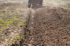 Ploughing in the fields Royalty Free Stock Images