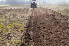 Ploughing in the fields Stock Images