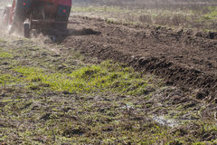 Ploughing in the fields Stock Photography