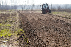 Ploughing in the fields Stock Image