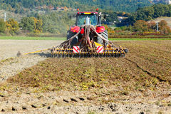 Ploughing heavy tractor during cultivation Stock Photo