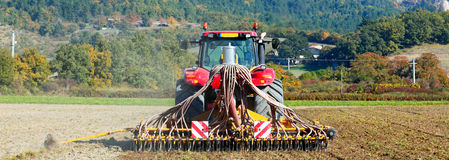 Ploughing heavy tractor during cultivation Royalty Free Stock Photography