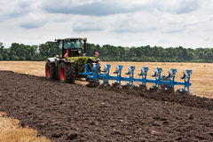 Ploughing of land Stock Image