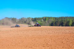 Ploughing tractor. During cultivation agriculture works at field with plough Royalty Free Stock Photos