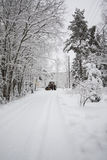 Ploughing. Tractor cleaning a road from snow Stock Photo