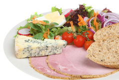 Ploughman's Lunch. Traditional British Ploughman's lunch with mature stilton cheese and ham Royalty Free Stock Photography
