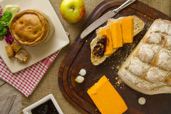 Ploughman's Lunch Spread from above with cut bread Stock Photos