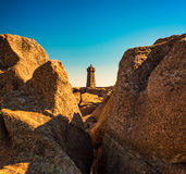 Ploumanac`h lighthouse between the rocks in pink granite coast, Royalty Free Stock Images