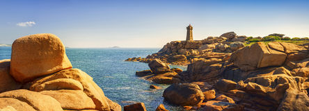 Ploumanach lighthouse in pink granite coast, Brittany, France. Royalty Free Stock Image