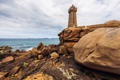 Ploumanach Lighthouse. On the shore. Perros-Guirec, Brittany, France Royalty Free Stock Photography