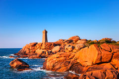 Ploumanach lighthouse sunset in pink granite coast, Brittany, Fr Stock Image
