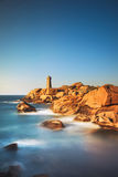 Ploumanach lighthouse sunset in pink granite coast, Brittany, Fr. Ploumanach Mean Ruz lighthouse red sunset in pink granite coast, Perros Guirec, Brittany Stock Photography