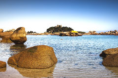 Ploumanach, rock and bay beach. Toned. Brittany, France. Ploumanach, ock and bay beach in morning. Toned. Pink granite coast, Perros Guirec, Brittany, France Royalty Free Stock Images