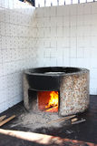 Plov cooking, huge cauldron with the pilaf Stock Photography