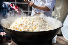Plov Kazakh national food. Big pot with Plov national Kazakh food on the street of Almaty during Nauryz festival in Kazakhstan Stock Photos