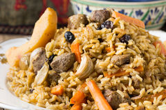 Plov with lamb meat, quince and raisins Stock Photos
