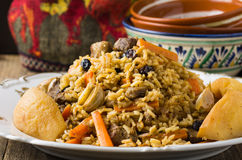 Plov with lamb meat, quince and raisins Royalty Free Stock Photos
