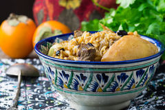 Plov with lamb meat, quince and raisins Royalty Free Stock Image