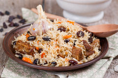 Plov, pilaf with rice, meat, raisins. On the plate Stock Photography