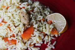 Plov. Vegan fresh tasty dish. rise with carrot, soya meat and garlic royalty free stock photos
