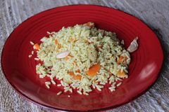 Plov. Vegan fresh tasty dish. rise with carrot, soya meat and garlic royalty free stock photo
