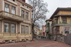 Houses and street in the center of city of Plovdiv, Bulgaria. PLOVDIV, BULGARIA - DECEMBER 30, 2016: Houses and street in the center of city of Plovdiv, Bulgaria Royalty Free Stock Image