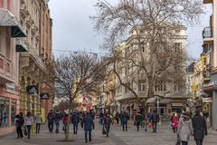 Walking people at the central pedestrian street in city of Plovdiv, Bulgaria. PLOVDIV, BULGARIA - DECEMBER 30, 2016: Walking people at the central pedestrian royalty free stock photos