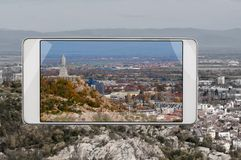 Plovdiv, Bulgaria in smartphone`s frame. Aerial view of bulgarian city Plovdiv, concept of new features of smart device, improvement of the image to feel real stock images