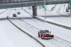 Plow car on I-95 after winter storm Stock Images