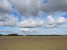 Plow field and beautiful sky Royalty Free Stock Image