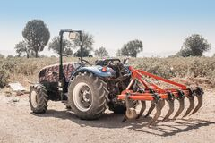 Free Plow For Cultivating The Soil Is Attached To A Dusty Tractor. Equipment In Industry Of Royalty Free Stock Photos - 199507708